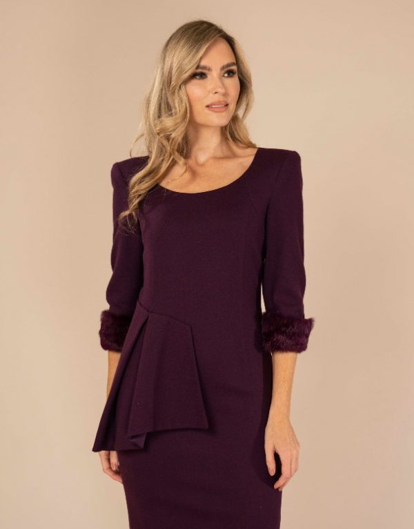 A 100% wool flattering midi length dress with raised asymmetrical neckline