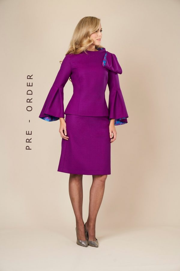 100% wool crepe top and skirt. This top features exaggerated single shoulder bow
